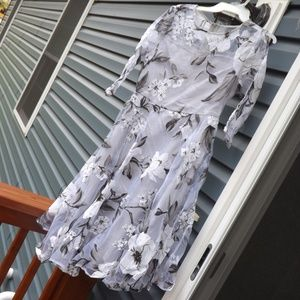 Grey floral dress with long sleeves.